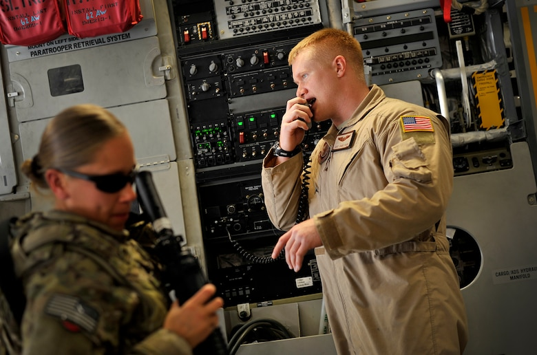 U.S. Air Force Staff Sgt. James Harp, C-17 Globemaster III loadmaster, gives instructions to passengers during a redeployment mission headed for Afghanistan, Sept. 15, 2012. Sgt. Harp is currently part of the 817th Expeditionary Airlift Squadron, deployed to the Transit Center at Manas, Kyrgyzstan. The 817th and their C-17s are an integral piece of the redeployment mission and help to move passengers and cargo within the area of operation.