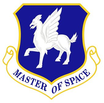 Blue, chevron-shaped emblem outlined in gold depicting the opinicus, a mythological creature with the head and wings of an eagle, the body of a lion, the legs of a horse, and the tail of a bear.  A white scroll beneath the chevron reads: Master of Space