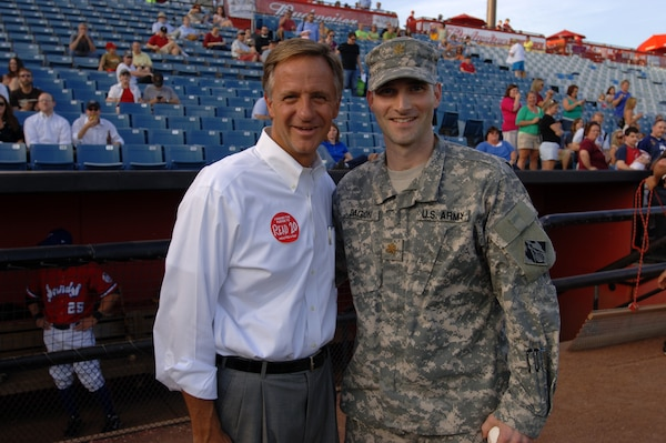 Maj. Patrick Dagon (Right), U.S. Army Corps of Engineers Nashville District deputy commander, meets Tennessee Gov. Bill Haslam at the Nashville Sounds game June 14, 2012. The major threw out the first pitch in honor of the Army's birthday. (USACE photo by Leon Roberts)