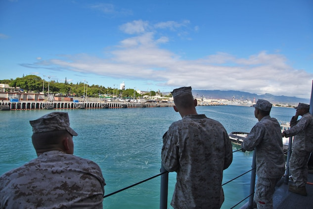 Marines from the 15th Marine Expeditionary Unit watch as the USS Rushmore leaves U.S. Naval Base Pearl Harbor, Hawaii, a week into the unit's Western Pacific Deployment, Sept. 25. The MEU and Peleliu Amphibious Ready Group will continue their deployment, where they plan to conduct theater security cooperation exercises and humanitarian operations.