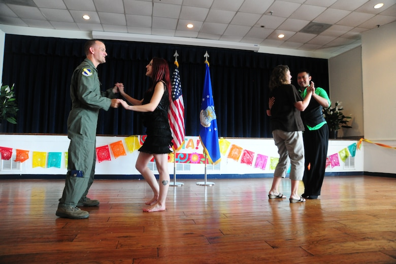 Joint Base Andrews came together to enjoy a Hispanic Heritage-American Month celebration at the community activity center Sept. 21, 2012. The event included a free ethnic-food tasting, a professional dancing demonstration, a live DJ and an opportunity for patrons to dance. (U.S. Air Force photo/Senior Airman Amber Russell)