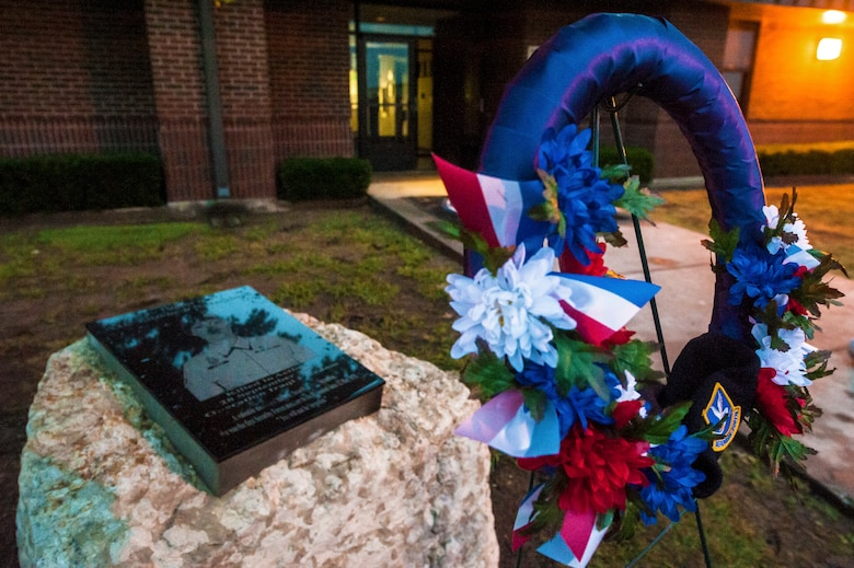 GOODFELLOW AIR FORCE BASE, Texas – A wreath is laid in front of Airman 1st Class Elizabeth Jacobson's Memorial to commemorate her sacrifice Sept. 28, 2012. This year marks the seventh anniversary of her death. Jacobson was the first security forces member as well as the first Air Force female to be killed in action in Operation Iraqi Freedom in 2005 by a roadside bomb. (U.S. Air Force photo/Airman 1st Class Michael Smith)