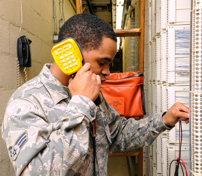 Senior Airman Miguel Reed, 2nd Communications Squadron Infrastructure Flight, uses a lineman's handset, more commonly known as a butt-set, on Barksdale Air Force Base, La., Sept. 25. Infrastructure flight Airmen use these handsets to test phone lines to monitor if they are functioning correctly and perform the proper maintenance should they find a faulty line. (U.S. Air Force photo/Airman 1st Class Andrew Moua)(RELEASED)