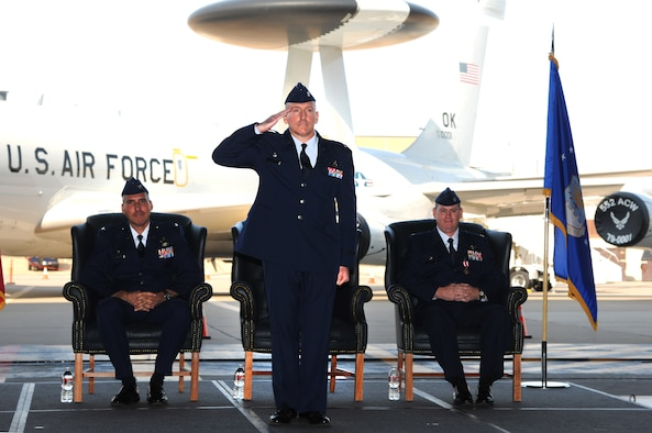 Lt. Col. Anthony Kleiger receives his first salute from members of the 965th Airborne Air Control Squadron shortly after assuming command of the squadron from Lt. Col. Peter Mykytyn, right, in a ceremony Sept. 20 in Bldg. 230, Dock 2. Colonel Kleiger had previously served as the Director of Operations for the 552nd Operations Support Squadron. Col. John Cooper, 552nd Operations Group commander, left, served as the presiding officer for the ceremony. (Air Force photo by David Faytinger)