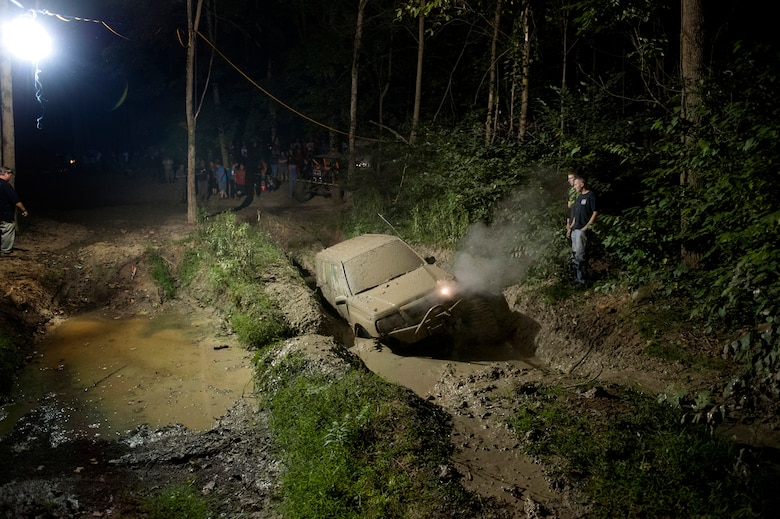 A vehicle gets stuck in a mud pit during a mud bugging competition of the Big Dog Off-Road event in Gore, Va., Sept. 15, 2012. (U.S. Air Force photo/Val Gempis)