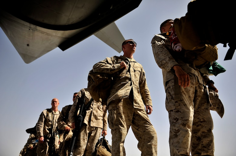 U.S. Marines board an Air Force C-17 Globemaster III during a redeployment mission at Camp Bastion Airfield, Afghanistan, Sept. 11, 2012. The U.S. military is drawing down forces in Afghanistan and redeploying combat forces while transitioning security control to the Afghan National Security Forces. The ANSF and U.S. forces have worked closely and effectively to transition control of security in Afghanistan. (U.S. Air Force photo/Staff Sgt. Clay Lancaster)