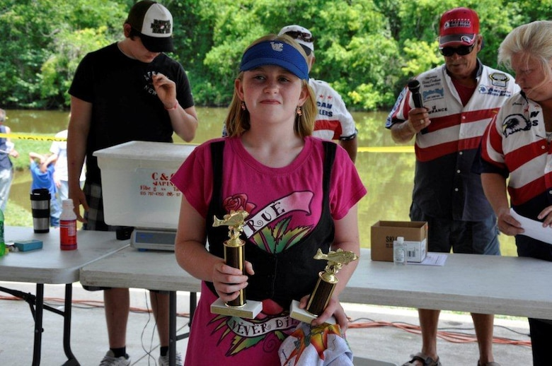 Patricia Worthington, 12, received two trophies; one for largest fish at 4.95 pounds, and she placed second in total weight with 9.25 pounds of fish caught in the 11-15 age group at the Cheatham Lake Fish Bustin' Rodeo June 9, 2012. (USACE photo by Fred Tucker)