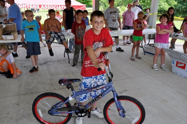 Trevor Honeycutt, 12, proudly displays the bike he won in a drawing at the Cheatham Lake Fish Bustin' Rodeo June 9, 2012. (USACE photo by Fred Tucker)