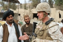 (Tangye, AFGHANISTAN) - Maj Jackson , a South Asia FAO and governance and development advisor, speaks with a general store owner and his workers. For the first time since 2006, businesses began returning to the Tangye Bazaar after coalition forces cleared the area of insurgents and brought security to the Kajaki district center.