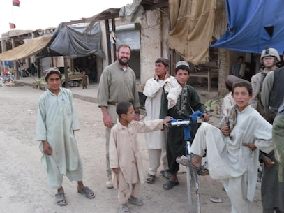 LtCol Carroll with Afghan children while on ICT