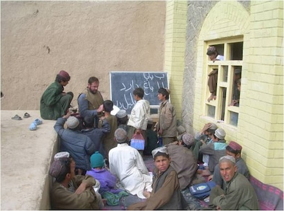 Marine FAO LtCol Carroll teaching Afghan students in Now Zad