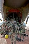 Marine FAO LtCol Madden boards a French C-160 w/French and Senegalese troops