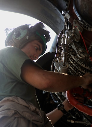 A Marine with Marine Medium Tiltrotor Squadron 261 (Reinforced), 24th Marine Expeditionary Unit, performs corrosion preventative maintenance on a CH-53E Super Stallion helicopter aboard the USS New York, Sept. 29.