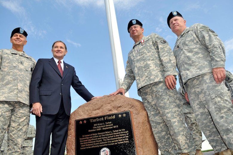 The Adjutant General of the Utah National Guard, Jefferson S. Burton (left), Utah Governor Gary Herbert, Maj. Gen. Brian Tarbet and Command Sgt. Maj. Micheal Miller pose by the newly dedicated monumet to Tarbet on the occasion of his retirement from service as the Utah Adjutant General at Camp Williams Utah, Sept. 28 2012. (Air Force Photo by TSgt. Jeremy Giacoletto-Stegall/Released)