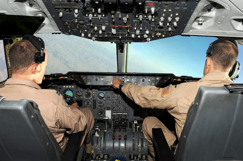 SOUTHWEST ASIA - U.S. Air Force Capt. Vincent Wright, aircraft commander, left, and 1st Lt. Kurt Rommel, co-pilot, right, fly a KC-10 Extender during refueling operations Sept. 18, 2012. Wright and Rommel are deployed to the 380th Air Expeditionary Wing as part of the 908th Expeditionary Aerial Refueling Squadron. (U.S. Air Force photo/Master Sgt. Scott MacKay)