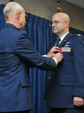 JOINT BASE ELMENDORF-RICHARDSON, Alaska - Col. Robert A. K. Doehl, the 176 Wing vice commander, celebrates his retirement here Sep. 23. Doehl received a retirement ribbon. Alaska Air National Guard photo by Staff Sgt. N. Alicia Goldberger