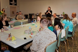 Candace Fuller encourages attendees to ask questions during a Spouse Readiness Seminar, where twenty-one spouses learned about various topics related to military life, here March 28. Fuller is the family readiness officer for Security and Emergency Services Battalion.
