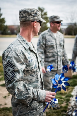 U.S. Air Force Chief Master Sgt. John Weimer, 366th Fighter Wing command chief master sergeant, holds a pinwheel for planting near the main gate at Mountain Home Air Force Base, Idaho, in recognition of Child Abuse Prevention Month April 1, 2013. (U.S. Air Force photo/Tech. Sgt. Samuel Morse)