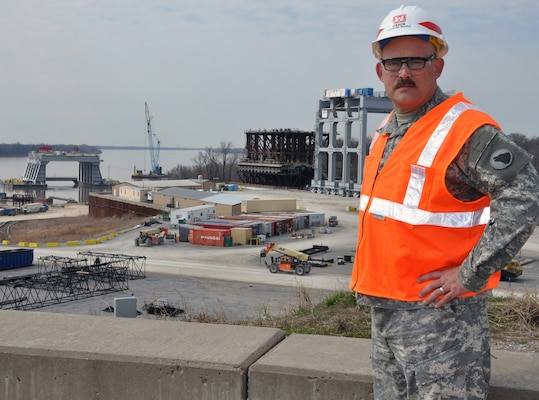 "As part of DoD's intern program for convalescing wounded warriors, Staff Sgt. Jackie Wallace is assigned to the Corps of Engineers' Olmsted Locks and Dam construction project on the Ohio River. ""I'd definitely recommend the internship to other Soldiers,"" Wallace said. ""It continues your education, keeps your mind going and challenges you to do something different."""