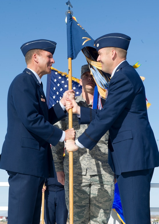 Lt. Col. Shawn Anger, 7th Fighter Squadron incoming commander, assumes command of the 7th FS from Col. Kenneth Johnson, 49th Operations Group commander during the change of command ceremony at Holloman Air Force, N.M., April 1. Anger has been the operations officer for the 7th FS and the 49th Operations Support Squadron since May 2011. (U.S. Air Force photo by Senior Airman DeAndre Curtiss/Released)