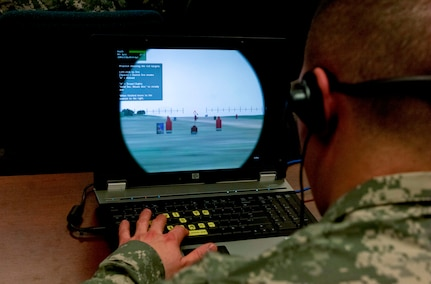 A Soldier aims at a target while using the Virtual Battle Space 2 computer simulator at Fort Eustis, Va., March 11, 2013. VBS2 is a fully interactive training system that provides a virtual environment suitable for a wide range of military training. (U.S. Air Force photo by Airman 1st Class R. Alex Durbin/Released)