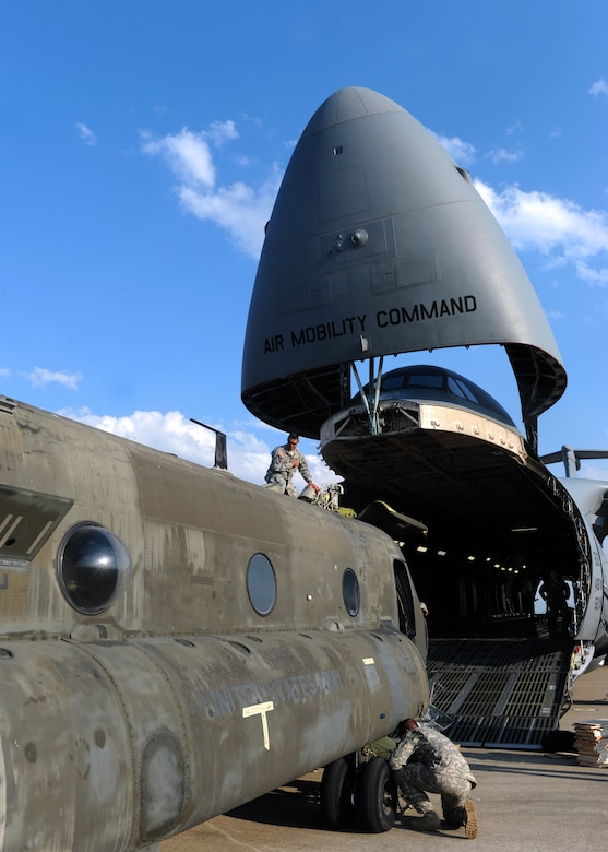 Soldiers from the 1st Battalion, 228th Aviation Regiment and Airmen from the 709th Airlift squadron, 512th Air Wing, Dover Air Force Base, load A U.S. Army CH-47 Chinook into a C-5M Super Galaxy for transportation back to Delaware, March 30. Soto Cano Air Base maintains the only strategic day and night, all-weather C-5 capable airfield in the region that supports essential operations in Central America. (U.S. Air Force photo by Staff Sgt. Eric Donner)