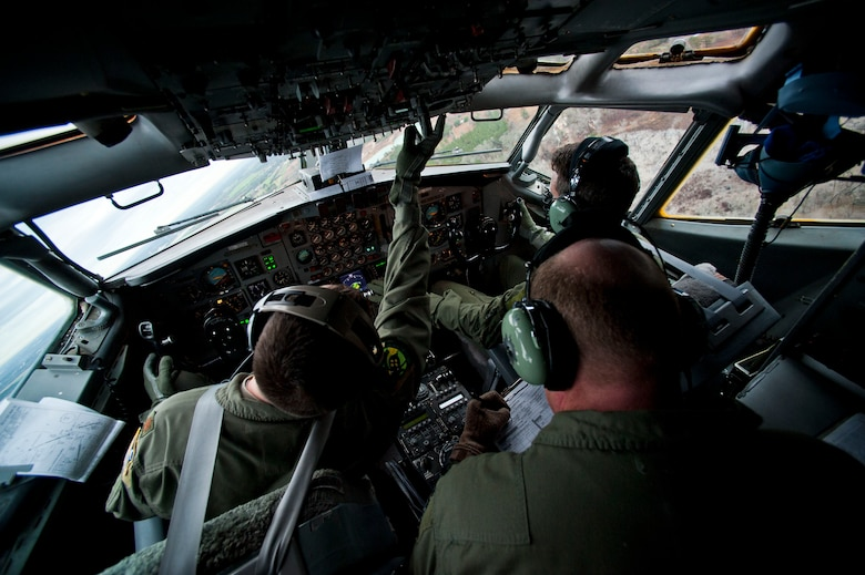 Air craft commander Maj. Ben (left) flies an E-8 Charlie along with co-pilot Capt. Ryan (top right), as flight engineer Senior Master Sgt. Curtis monitors the aircrafts systems during a training exercise for the Joint Surveillance and Target Attack Radar System at Warner Robins Air Force Base, Ga., Feb. 13, 2013.  (U.S. Air Force photo/Senior Airman Andrew Lee)