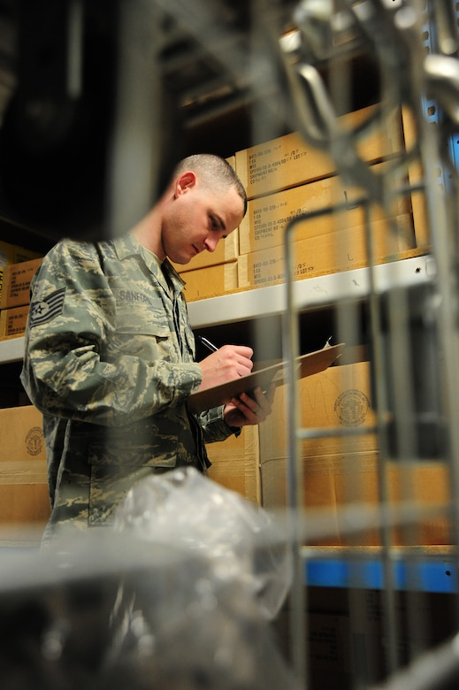 Tech. Sgt. Jeremy Sanford, 509th Security Forces Squadron NCOIC of supply, performs an inventory check on security forces equipment in the supply warehouse at Whiteman Air Force Base, Mo., March 20, 2013. Sanford issues, tracks, prepares and maintains $3.2 million of security forces equipment. (U.S. Air photo by Staff Sgt. Nick Wilson/Released)