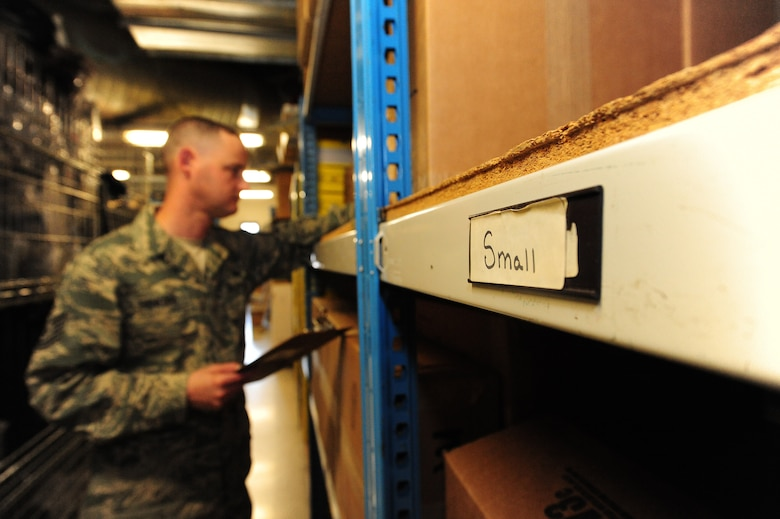 Tech. Sgt. Jeremy Sanford, 509th Security Forces Squadron NCOIC of supply, checks the serial numbers of cold-weather gear boxes during an inventory check at Whiteman Air Force Base, Mo., March 20. 2013. Sanford works alone in his office as the only enlisted person in charge of more than 5,000 security forces equipment items. (U.S. Air Force photo by Staff Sgt. Nick Wilson/Released)