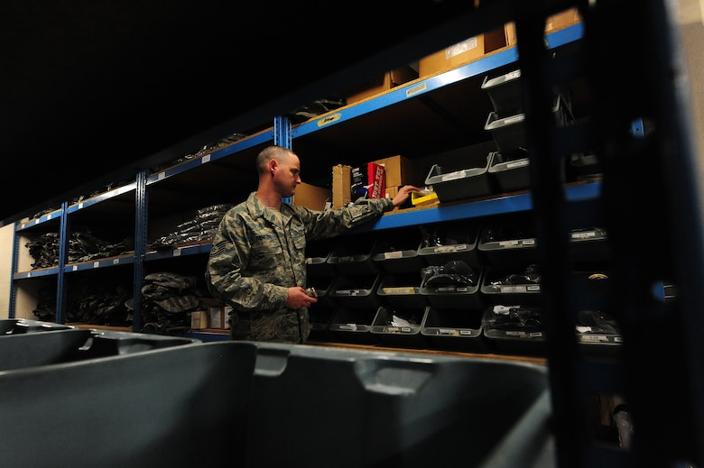 Tech. Sgt. Jeremy Sanford, 509th Security Forces Squadron NCOIC of supply, performs an inventory check on handcuffs at Whiteman Air Force Base, Mo., March 20, 2013. Sanford is responsible for accountability of more than 5,000 items totaling more than $3.2 million in value. (U.S. Air Force photo by Staff Sgt. Nick Wilson/Released)