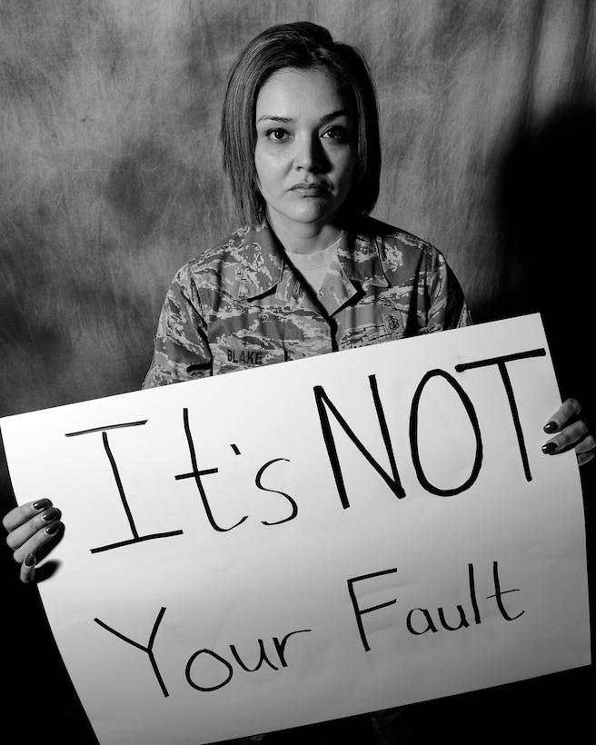 "ROYAL AIR FORCE LAKENHEATH, England—Master Sgt. Michelle Blake, 48th Medical Group flight chief for medical readiness, sends a message to women, ""It's NOT your fault"" April  2, 2013. Blake was a victim of sexual and domestic abuse and her story is being featured during Sexual Assault Awareness Month. (U.S. Air Force photo by Staff Sgt. Stephanie Mancha)"