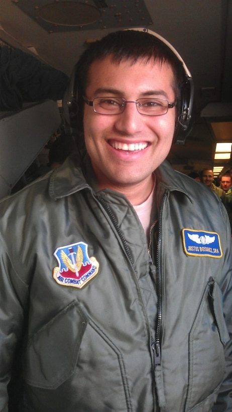 After receiving paperwork putting him back in flying status, Senior Airman Justus Bosquez took his first flight as an amputee March 25. The Airman, an E-3 air surveillance technician with the 965th Airborne Air Control Squadron, had his left leg amputated after a hit-and-run motorcycle accident in June 2011. (Courtesy photo)