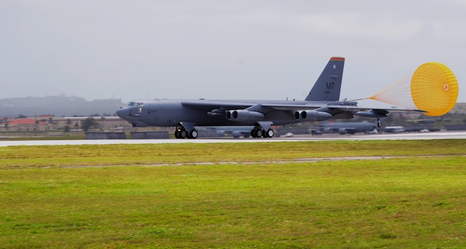 A B-52 Stratofortress from the 23rd Expeditionary Bomb Squadron, deployed from Minot Air Force Base, N.D., lands at Andersen AFB, Guam, April 2, 2013. The 23rd EBS arrived March 31 in relief of the 96th EBS from Barksdale AFB, La. and is deployed to Andersen to support U.S. Pacific Command's continuous bomber presence mission. (U.S. Air Force photo by Senior Airman Benjamin Wiseman/Released)