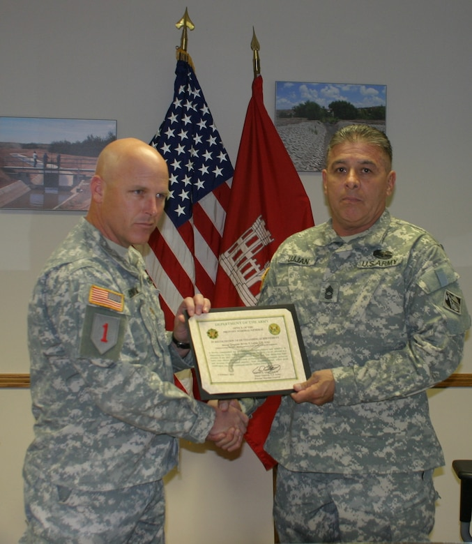 Master Sgt. Bernie Lujan receives the 2012 U.S. Army Antiterrorism Honor Roll Award at the Albuquerque District's Headquarters March 26, 2013.