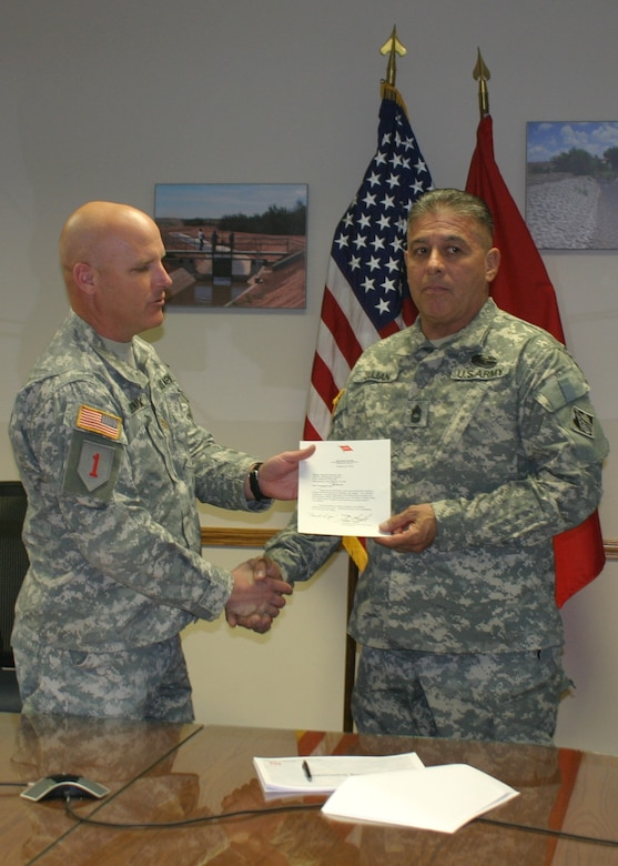 Master Sgt. Bernie Lujan receives the 2012 USACE Meritorious Antiterrorism Honor Roll Award at the Albuquerque District's Headquarters March 26, 2013.
