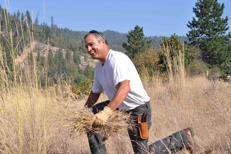 Upper Rogue Watershed Association Director Pete Mazzini is always supportive of his diverse network of groups and partners and attends nearly every event.  Here he gets his hands dirty pulling Southern Oregon's primary invasive weed threat, star thistle.
