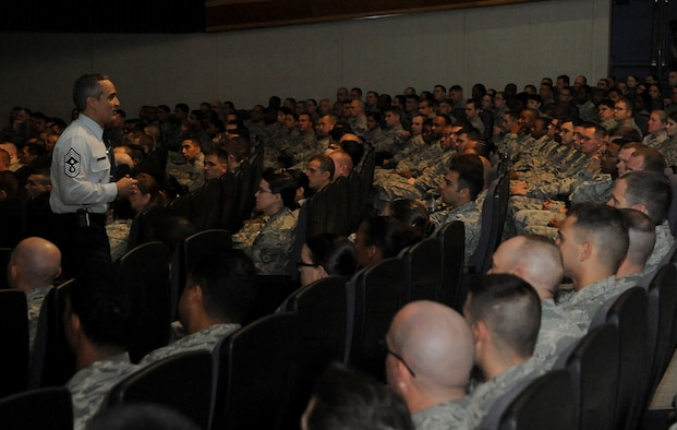 U.S. Air Force Chief Master Sgt. Ramon Colon-Lopez, 18th Wing command chief, speaks to a group of NCOs during an enlisted all-call on Kadena Air Base, Japan, April 4, 2013. This all-call targeted three specific groups; Airmen, NCOs and senior NCOs, to reemphasize their roles and responsibilities along with answer questions these groups may have had. (U.S. Air Force photo by Staff Sgt. Laszlo Babocsi/Released)