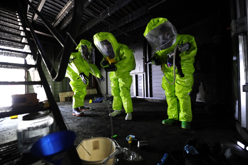 (Left to right) Tech. Sgt. Glynn Drummonds, 628th Medical Group bioenvironmental engineer journeyman, Michelle Bates, 628th Civil Engineer Squadron Emergency Management manager and Senior Airman Ross Kreikemeier, 628th Civil Engineer Squadron Emergency Management Flight, simulate scanning for hazardous substances during an exercise March 28, 2013, at Joint Base Charleston-Air Base, S.C. The exercise gave the Emergency Management and Bioenvironmental Flights an opportunity to train for possible real world situations that may involve all hazards that may present a physical threat to the environment at Air Force installations worldwide. (U.S. Air Force photo by Staff Sgt. Rasheen Douglas)