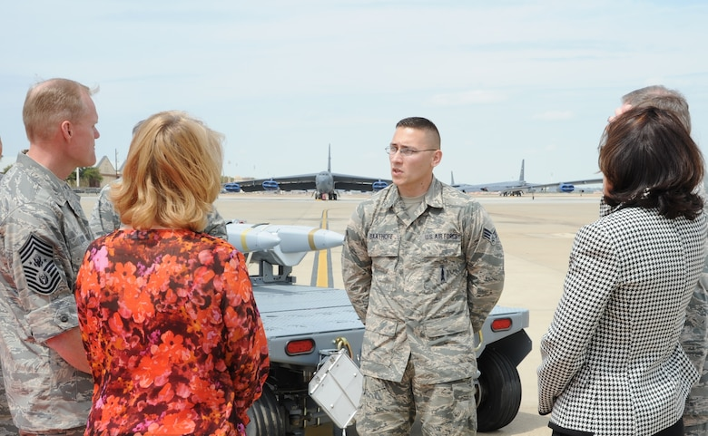 Senior Airman Richard Saathoff, a cruise missile technician with the 2nd Munitions Squadron, talks to Air Force Chief of Staff Gen. Mark A. Welsh III, Chief Master Sgt. of the Air Force James Cody and their spouses Betty Welsh and Athena Cody about B-52 munitions, April 2, 2013, at Barksdale Air Force Base, La. Welsh and Cody met with Air Force Global Strike Command Airmen during a two-day visit, reinforcing the importance of the command's deterrence and global strike mission. (U.S. Air Force photo/Airman 1st Class Joseph Pagan)