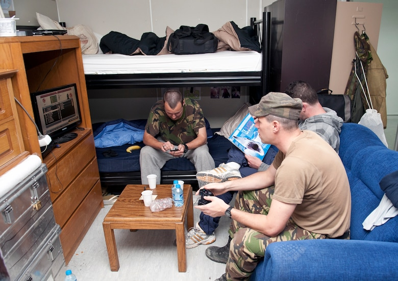 Dutch army soldiers relax during their off time in their room in Patriot Village Feb. 22, 2013, at Incirlik Air Base, Turkey. Patriot Village is Incirlik's contingency lodging facility capable of housing more than 1,200 people. (U.S. Air Force photo by Senior Airman Daniel Phelps/Released)