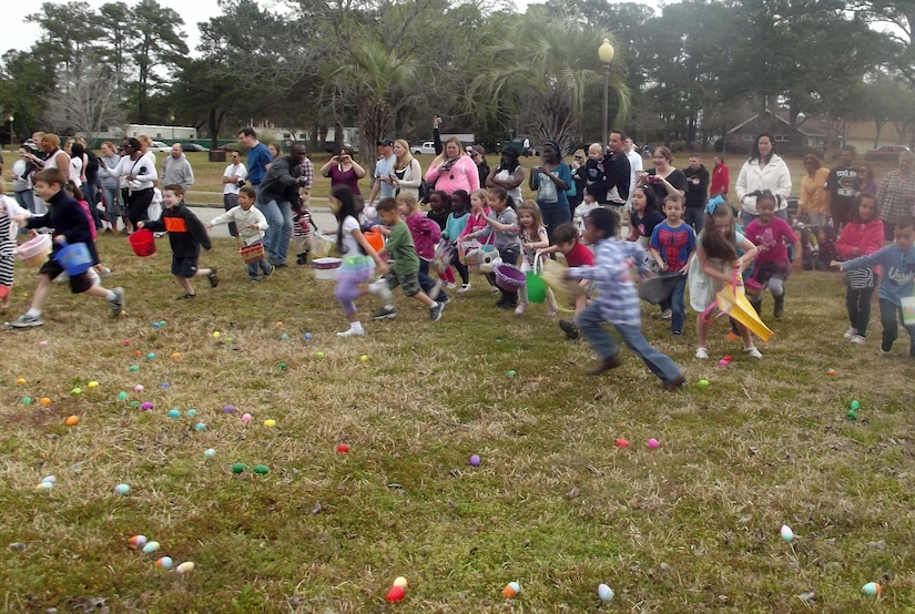 Children collect eggs during the Easter Egg Hunt at the annual Easter Event March 30, 2013, at Joint Base Charleston – Air Base, S.C. More than 200 JB Charleston youth hunted for eggs at the event put on by Air Base Youth Programs.  Participants enjoyed hunting for eggs, visiting with the Easter Bunny, and face painting. (Courtesy Photo)