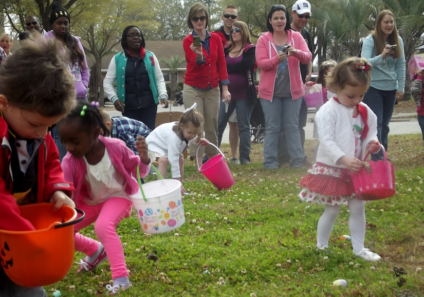 Children search for eggs during the Easter Egg Hunt at the annual Easter Event March 30, 2013, at Joint Base Charleston – Air Base, S.C. More than 200 JB Charleston youth hunted for eggs at this event put on by Air Base Youth Programs.  Participants enjoyed hunting for eggs, visiting with the Easter Bunny, and face painting. (Courtesy Photo)