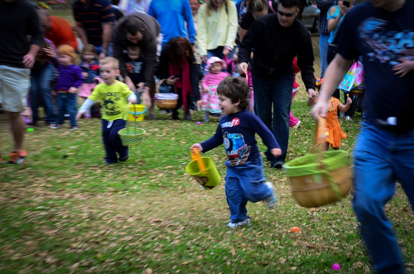 Children in the youngest age group and their parents look for eggs during the Easter Egg Hunt at the annual Easter Event March 30, 2013, at Marrington Plantation on Joint Base Charleston – Weapons Station, S.C. More than 500 participants attended this year's event, according to Robert Veronee, JB Charleston – Weapons Station Youth Center coordinator. (U.S. Air Force photo/Staff Sgt. Anthony Hyatt)