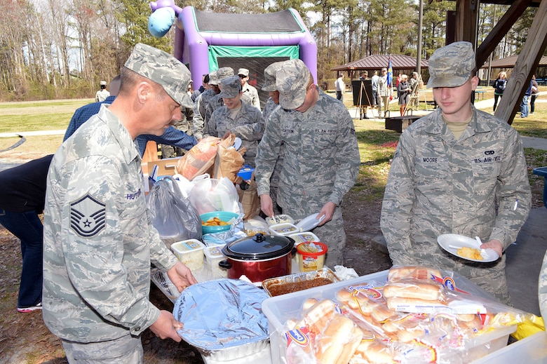 3rd Aerial Port Squadron Airmen and family members go through the food line during a picnic March 29 celebrating the squadron's 60th Anniversary at Pope Army Airfield, Fort Bragg, N.C.