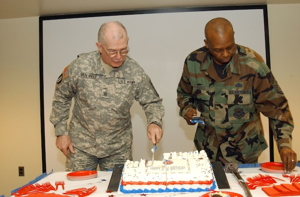 Command Chief Master Sergeant Hardy Pierce (right) and Command Sergeant Major Robert Van Pelt finish cutting the National Guard Birthday cake in the Department of Military and Naval Affairs auditorium in Latham, N.Y. Dec. 13, 2007