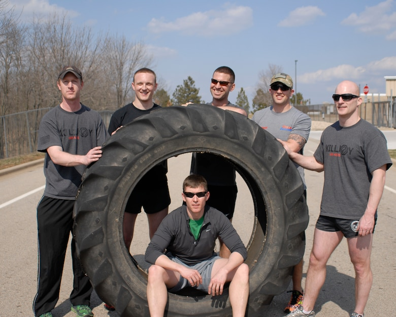 U.S. Air Force Tactical Air Control Party specialists of the 169th Air Support Operations Squadron rest next to a 230 pound tractor tire they flipped across the final lap of the TACP Association 24 Hour Run Challenge at the 182nd Airlift Wing in Peoria, Ill., March 29, 2013.  Sixty-two runners ran 161.75 miles around the installation over the course of 24 hours and raised over $8,200 in support of the TACP community and their families.  The 182nd team also ran in remembrance of Staff Sgt. Jacob Frazier, a member of the Peoria-based 169th Air Support Operations Squadron who was killed in action near Geresk, Afghanistan, exactly 10 years earlier.  (U.S. Air Force photo by Staff Sgt. Lealan Buehrer//Released)