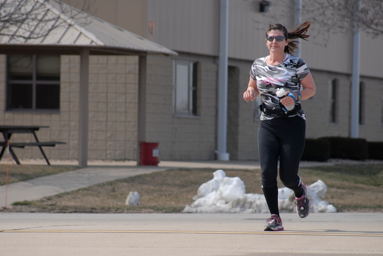 U.S. Air Force Maj. Patricia Thompson runs one of 15 miles during the  second annual Tactical Air Control Party Association 24 Hour Run Challenge at the 182nd Airlift Wing in Peoria, Ill., March 29, 2013.  Sixty-two runners ran 161.75 miles around the installation over the course of 24 hours and raised over $8,200 in support of the TACP community and their families.  The 182nd team also ran in remembrance of Staff Sgt. Jacob Frazier, a member of the Peoria-based 169th Air Support Operations Squadron who was killed in action near Geresk, Afghanistan, exactly 10 years earlier.  (U.S. Air Force photo by Staff Sgt. Lealan Buehrer//Released)