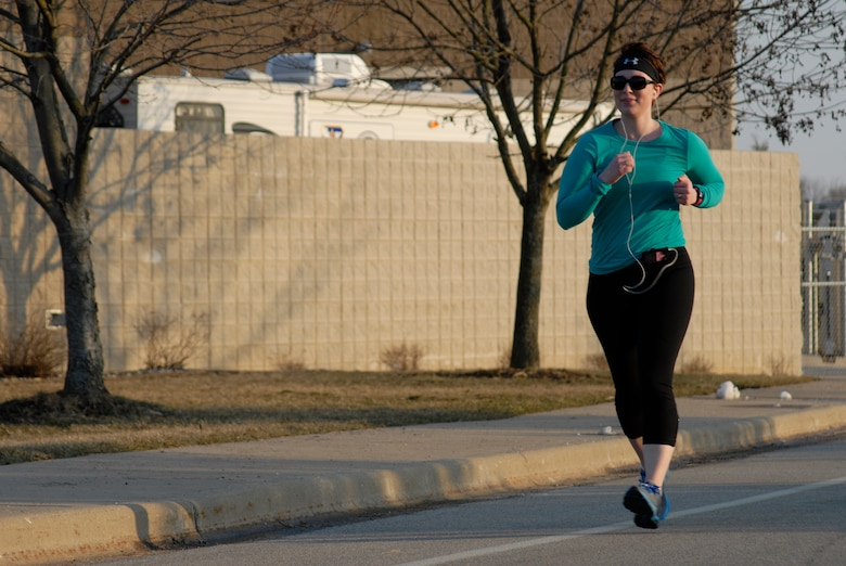 U.S. Army Sgt. Krysta Theobald runs one of five miles during the second annual Tactical Air Control Party Association 24 Hour Run Challenge at the 182nd Airlift Wing in Peoria, Ill., March 28, 2013.  Sixty-two runners ran 161.75 miles around the installation over the course of 24 hours and raised over $8,200 in support of the TACP community and their families.  The 182nd team also ran in remembrance of Staff Sgt. Jacob Frazier, a member of the Peoria-based 169th Air Support Operations Squadron who was killed in action near Geresk, Afghanistan, 10 years earlier on March 29, 2003.  (U.S. Air Force photo by Staff Sgt. Lealan Buehrer//Released)