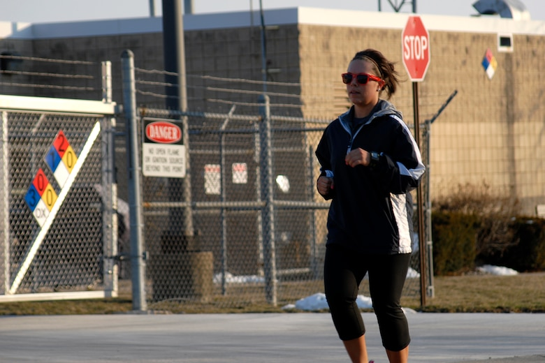 U.S. Air Force Senior Airman Jenna Calderone runs one of 12.5 miles at the second annual Tactical Air Control Party Association 24 Hour Run Challenge at the 182nd Airlift Wing in Peoria, Ill., March 28, 2013.  Sixty-two runners ran 161.75 miles around the installation over the course of 24 hours and raised over $8,200 in support of the TACP community and their families.  The 182nd team also ran in remembrance of Staff Sgt. Jacob Frazier, a member of the Peoria-based 169th Air Support Operations Squadron who was killed in action near Geresk, Afghanistan, 10 years earlier on March 29, 2003.  (U.S. Air Force photo by Staff Sgt. Lealan Buehrer//Released)
