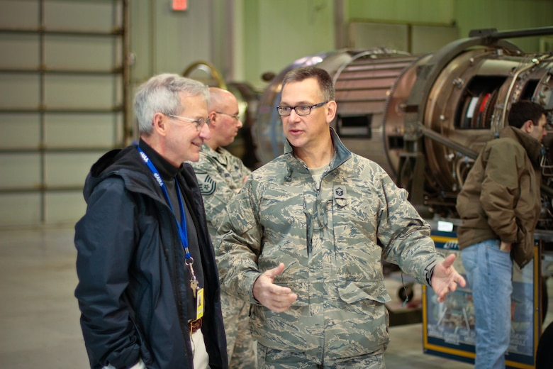 New Jersey Air National Guard Master Sgt. Andrew Moseley talks to aeronautical engineering professor Dr. Terry Hart from Lehigh University during a base tour on April 3, 2013. Hart is a former 177th Fighter Wing F-106 Delta Dart pilot, and was also a NASA Space Shuttle Astronaut. Moseley is the Multimedia Manager for the 177th Fighter Wing Public Affairs Office. (New Jersey Air National Guard photo by Tech. Sgt. Matt Hecht/Released)